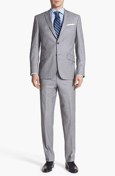 Free shipping and returns on Ted Baker London 'Jones' Trim Fit Wool Suit at Nordstrom.com. $695  A classic notch-lapel jacket cut from super 120s Italian wool serge is outlined with decorative pickstitching and paired with flat-front trousers. Bright, iridescent lining lends a fresh pop of color.