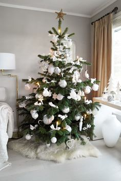 White Christmas tree with a hint of pink.