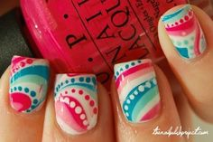 I love the idea of water marbeling the nails and then doing polka-dots along the waves of color.
