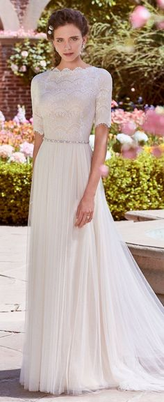 Rebecca Ingram - CATHY ANNE, This modest wedding dress features a lace bodice with elbow-length sleeves and a bateau neckline. A bead and Swarovski crystal belt atop a tulle skirt completes this vintage-inspired sheath.