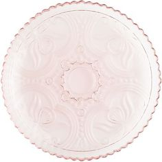 Every dish looks more delicious when it's served on our pretty plate in just the right shade of pink. Handcrafted with scrolling designs, it's a welcome addition to any tablescape or dinner table.