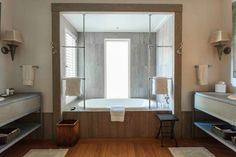 A clever trick for bathroom design is to ensure there's a symmetry between the fittings. Here, at the gorgeous Kauri...