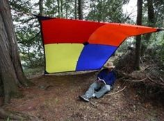 Tie a tarp between two trees to create a wind wall. | 23 Essential Winter Camping Hacks