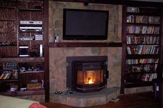 wood burning fireplace with tv above
