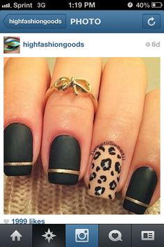 Leopard and matte black Nails! And I love the bow too!