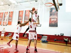 Jaylen Johnson (10) dunks the ball with help from Donovan Mitchell (45) and Matz Stockman during University of Louisville Men's Basketball Media Day at the Yum! Practice Facility. 11.2015