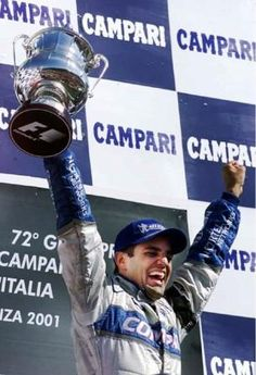 Juan Pablo Montoya celebrating victory in the 2001 Italian Grand Prix having driven a Williams-BMW.