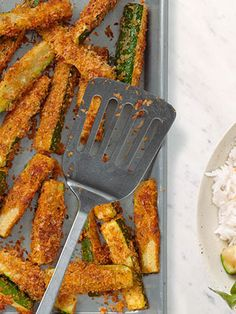 Crispy, cheesy zucchini oven fries are a sure-fire way to sneak extra veggies into dinner tonight.