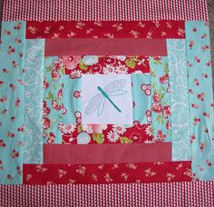 nice application of log cabin with center square being embroidery, novelty fabric, etc