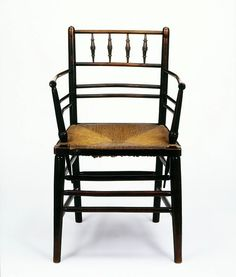 Sussex Armchairchair  London, England Date: 1870-1890 (made) ca. 1860 (designed)      Artist/Maker: Webb, Philip Speakman, (possibly, designer)  Morris & Co.         Ebonised beech, with a rush seat