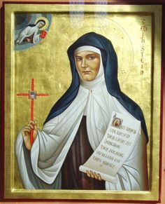 """Modern icon of Edith Stein (Oct 12,1891- August 9, 1942) German Jew, philosopher and teacher, Carmelite nun (Sr. Theresia Benedicta a Cruce), murdered in Auschwitz, Patron Saint of Europe. The writing in her hand says: """"The essence of love is dedication. The access to everything is the cross."""" Photo taken in the church of her baptism (January 1st, 1922), Bad Bergzabern."""