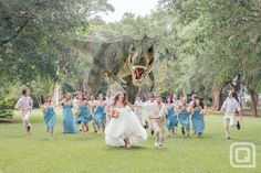 This photo of a dinosaur chasing the bridal party is the greatest wedding photo ever