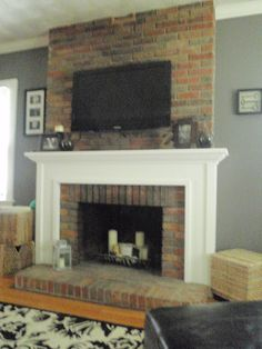Hammers and High Heels: Living Room: Mounting a TV to a Brick Fireplace Tv above fireplace Tv Over Fireplace, Build A Fireplace, Home Fireplace, Fireplace Remodel, Fireplace Surrounds, Fireplace Ideas, Tv Mantle, Fireplace Brick, Fireplace Update