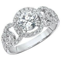 Halo style engagement ring by Phyllis Bergman- Avalon Park Jewelers  321-235-5553