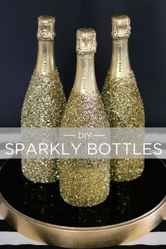 Fun DIY: Sparkly Champagne Bottles. You just need adhesive spray and lots and lots of craft glitter