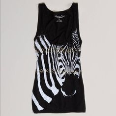 SALE American Eagle Black Studded Zebra Tank Super cute black racerback tank with a zebra graphic embellished with square studs.marked XXS but will fit XS as well. Worn only a couple times. Minor piling. No rips/tears/stains. Bundle for discounts! No ️️. American Eagle Outfitters Tops Tank Tops
