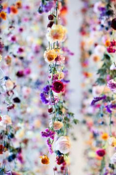 Rebecca Louise Law's art installations are constructed from cut flowers, often threaded on wire and suspended overhead.