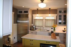 My kitchen remodel. We tore it down to the studs! I love my yellow island and it has tons of storage.