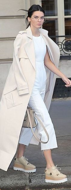 Who made Kendall Jenner's white jumpsuit, tan handbag, and star platform shoes?