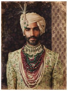 L'orient Exotique An uncut diamond and an emerald kalgi (turban pin) resting on a tissue maheshwari safa. Paired with hand embroidered… Mens Sherwani, Wedding Sherwani, Sherwani Groom, Wedding Dresses Men Indian, Wedding Dress Men, Wedding Wear, How To Tie Shoes, Indian Groom Wear, Indian Men Fashion