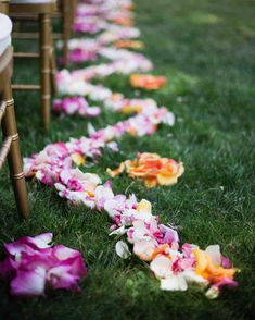 A Fun, Colorful Wedding in Guerneville, California | Martha Stewart Weddings - Scarlett & Grace arranged flower petals in a geometric pattern down the outdoor wedding ceremony aisle; the design mimicked the shape of the dinner tables. #weddingceremony #ceremonyideas #weddingflowers #weddingideas