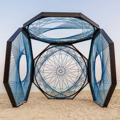 An other-worldly geometric installation on the beach that references the area's fishing heritage