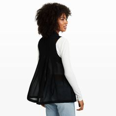 A timeless piece that fits effortlessly into your wardrobe, the Zoela features a minimalist silhouette and understated feminine details like a semi-sheer back panel in fluid silk with sewn-down pleat details for beautiful movement. Shell: acetate/viscose; back panel: silk; lining: polyester Relaxed fit 28' in length, based on a size M Open front; notched lapel; single button closure; side seam pockets; sewn down pleats at the back panel;