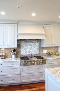 Wood Hood- tile back splash, granite counter tops, white painted cabinets