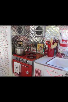 Vintage camper ~ love the silver backsplash!
