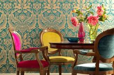 Eclectic Design was a hot design trend in 2012. (Love this large-scale wallpaper paired with brightly-colored chairs in the dining room!)