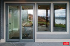BACKYARD PATIO ENTRANCE: Sliding patio doors and matching windows in Taupe.
