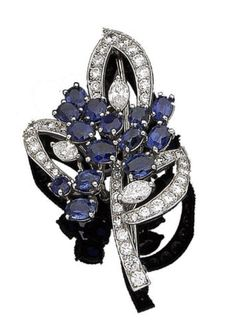 A sapphire and diamond brooch, by Cartier Of floral and foliate design, the flowers set with oval-cut sapphires and marquise-cut diamonds, the leaves set with brilliant-cut diamonds, diamonds approx. 2.70cts total, signed Cartier, numbered, length 4.9cm