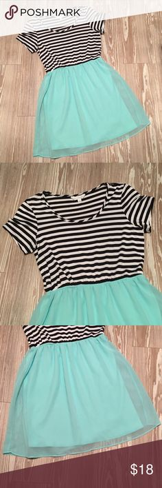 Charming Charlie Medium B&W Mint Color Block Dress Gently used Charming Charlie cap sleeve dress in juniors size medium. Top is a jersey knit feel with black and white stripes. The skirt is a mint color, with a shear fabric over a lining of similar color. Approximately above the knee in length. Some general wear, including some pilling on the top. In good condition.  Made in Vietnam Sleeves 8 in Bust 16 in Waist 14 in Length 34 in AC Charming Charlie Dresses Mini