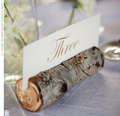 ski wedding ideas | The couple displayed their table numbers in log holders, made from ...