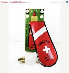 What constitutes an emergency? Looks like this cool little flask slips right onto a belt. (Vintage Flask First Aid with Original Box by MyChouChou, $11.25)