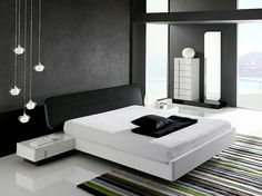 Dramatic minimalist bedroom makes a bold visual statement 50 Minimalist Bedroom Ideas That Blend Aesthetics With Practicality