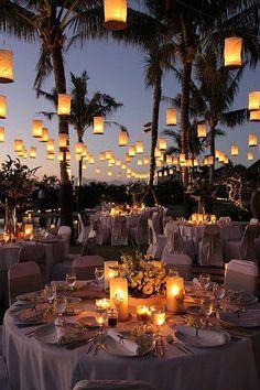 Romantic outdoor white tropical wedding reception with unique lantern decor; Featured Photographer: Santana Photography