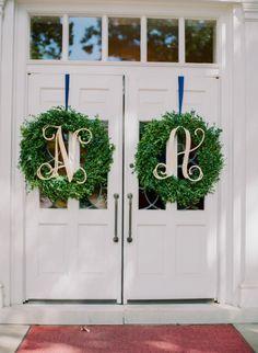 Monogram wreath decor: http://www.stylemepretty.com/missouri-weddings/2015/02/23/traditional-ballroom-wedding-10/ | Photography: Jordan Brittley - http://jordanbrittley.com/