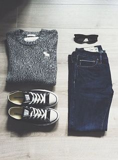Relaxed and casual outfit - sweater, sunglasses, sneakers, and jeans.