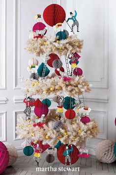 This display offers a different take on a three-ring circus is from our former crafts director, Marcie McGoldrick. She wanted to create a fun, colorful tree. And used vintage paper figures, and she made clip art of circus performers and animals to use as ornaments. #christmas #holidayideas #christmasideas #wintertodo #marthastewart Creative Christmas Trees, Christmas Tree Decorations, Christmas Time, Holiday Decor, Ornament Wreath, Ornaments, Colorful Trees, Tree Toppers, Christmas Inspiration