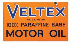 Sign for Veltex 100% Paraffine Base Motor Oil.