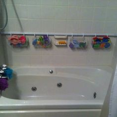 Instead of buying an expensive rack for the shower, buy an expandable shower curtain rod! Add baskets and hooks and voila. A great way to store all your shower stuff!