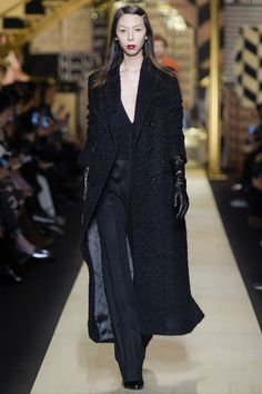 Black Top with a Plunging V Neckline, Black Pants and Black Lightweight Overcoat by Max Mara Fall 2016 Ready-to-Wear Fashion Show