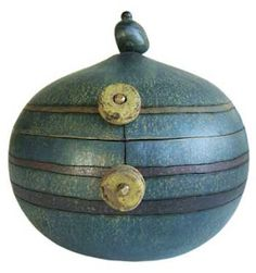 embellished, wood-burned and colored gourd vessels by Charlotte Masi