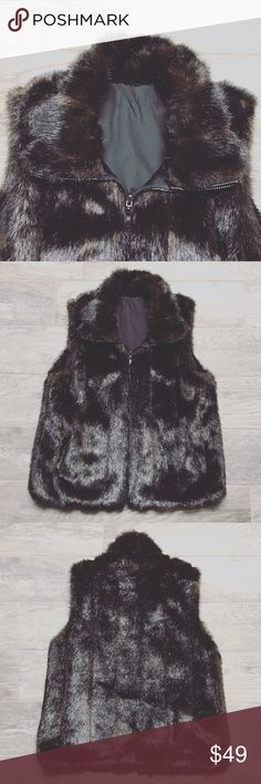 Gallery faux fur vest Used in perfect condition!  -Dark brownish black faux fur -faux fur shell 52% modacrylic 30% polyester 18% acrylic -Reverse shell 100% polyester  -2 outside front pockets -2 inside pockets  -Zipper for closure   ⚜️NO TRADES ⚜️OFFERS WELCOMED! ⚜️BUNDLE TO SAVE ⚜️FEEL FREE TO ASK ANY QUESTIONS! Jackets & Coats Vests