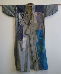 Long Boro Kimono. Shown inside out. Can you imagine the person wearing it...perhaps for house cleaning or farm work only...or just someone very poor. Now we think it's beautiful and even exotic.