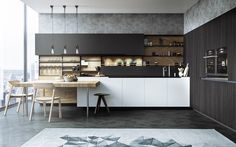 The are rug and wall pattern in this kitchen give its sleek design just enough texture to warm it up.