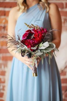 Burgundy and Dusty Blue Fall Wedding Color Ideas: White bride with burgundy bouquets together with dusty blue bridesmaids, Groom and groomsmen in deep grey suit with burgundy tie, burgundy centerpieces and dusty blue candles… Cranberry Wedding Colors, Burgundy Wedding Flowers, Burgundy Bouquet, Burgundy Bridesmaid, Blue Bridesmaids, Fall Wedding Colors, Bridesmaid Bouquet, Red Wedding, Wedding Bouquets