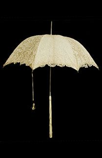 Brussels lace parasol with ivory handle, 1860s. Made from handmade Brussels lace and lined with matching cream-colored silk, such a fancy parasol was more of a status symbol and fashion accessory than a sun shield.