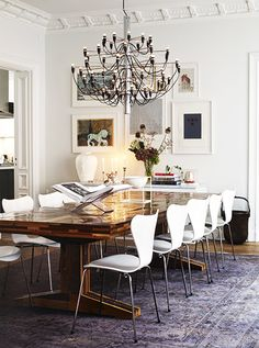 An overdyed rug is a great foundation for the pairing of simple modern chairs with a great custom trestle dining table.